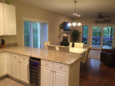 Come enjoy this open plan and treehouse view of the tennis court and pool