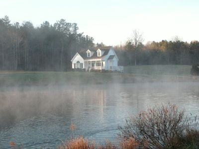 Mist rises from the pond at the Guest House
