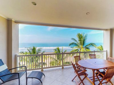 Photo for Stunning beachfront condo with shared pool and sweeping ocean views