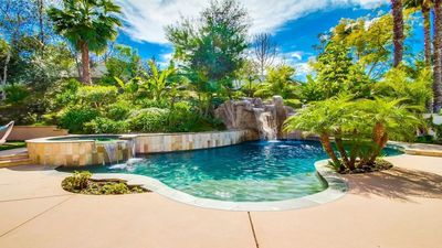 Large Custom Pool with Jacuzzi, Grotto, Waterfalls, & Waterslide