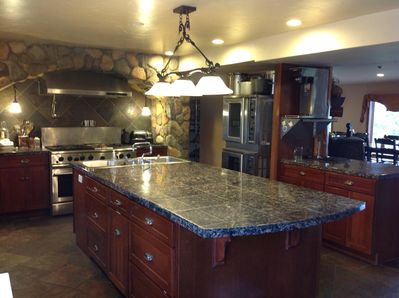 Gourmet, commercial kitchen in Ranch house.