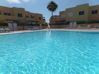 Photo for SUNNY APARTMENT WITH POOL A FEW STEPS FROM THE SEA