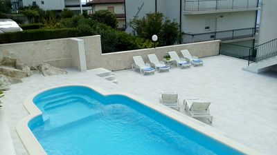 Photo for Comfort apartmant with terrace, sea view and pool near beach