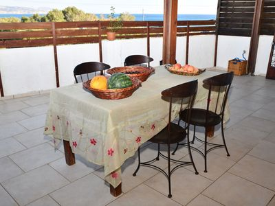 Photo for Vintage chic seaside maisonette is located on just a few meters from the beach.