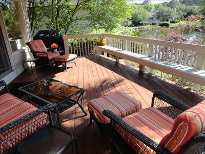 Sitting area on the deck with grill.