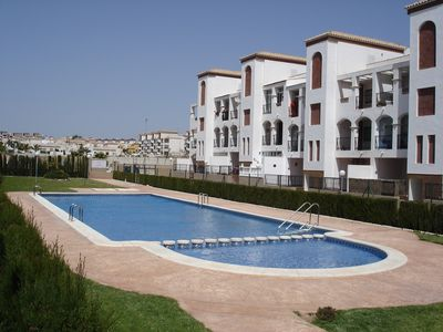 Photo for Sunny, Ground Floor Apartment in Punta Prima.  FREE wifi and air con.