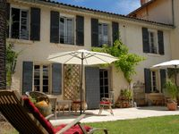 A charming villa in lovely grounds, close to the beach