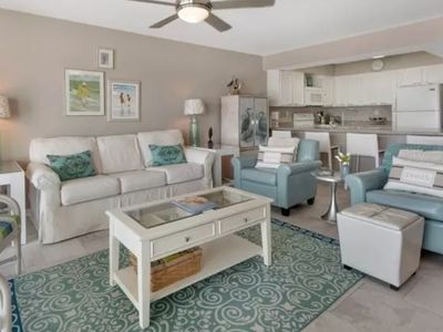 Photo for Beach chic condo steps to the beach! Close to shopping and dining!