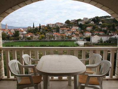 Photo for Two bedroom apartment with terrace and sea view Postira (Brač) (A-700-b)