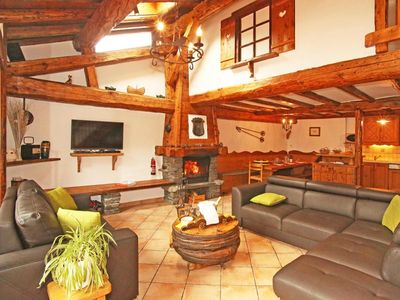 Photo for Surface area : about 120 m². Living room with fireplace. Bedroom with double bed, 2 bunk beds