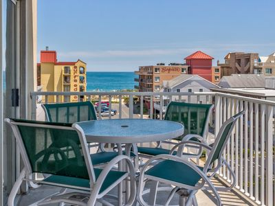 Photo for Charming condo w/ shared pool and ocean view, only one block to the beach!