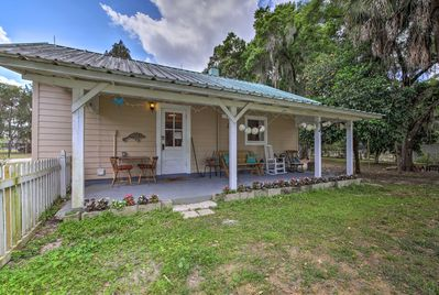 Relax on the cottage's covered porch with a cold glass of sweet tea.