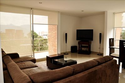 Living room with outside sitting in balcony 42 inch plasma with amazing views.