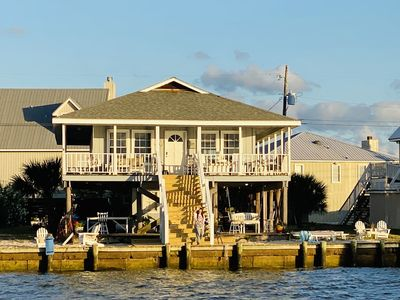 Photo for Waterfront house w/swim ladder, floating mat, kayaks/paddle-boards & SUNSETS!!