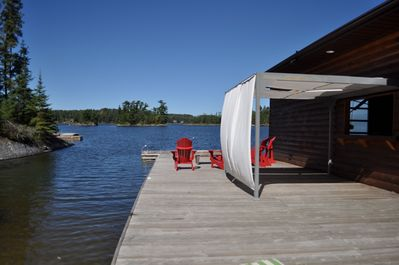 Spacious private dock with boathouse & fridge