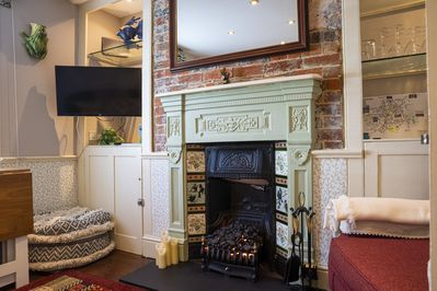 Lounge with electric  convector fire.
