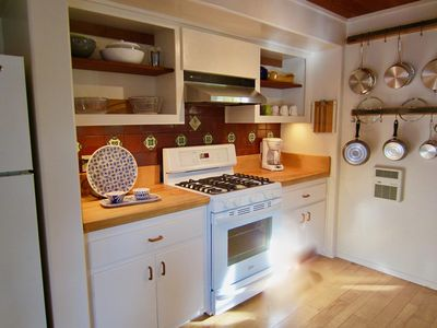 A well-equipped kitchen, with blender, mixer, convection oven and dishwasher .