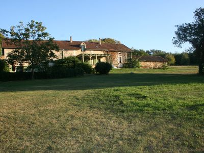 Photo for Gîtes of the Castle of Monciaux: Cottage cherry 2 bedrooms, tennis, swimming pool