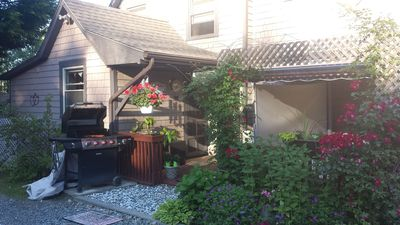 View from driveway with Gas Grill  and entry into your rental