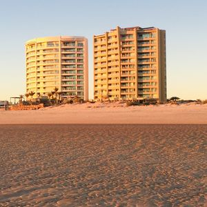 Luna Blanca on the left, Encanto Living on the right. Shot from the beach.