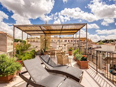 Photo for Trastevere Attic apartment in Trastevere with WiFi, air conditioning & private roof terrace.