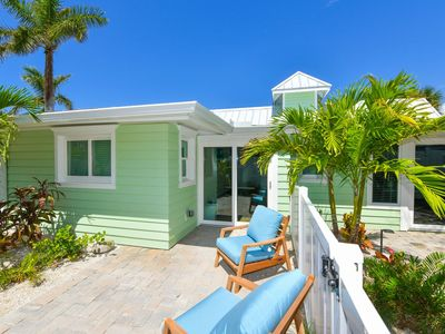 Photo for Tropical Breeze Resort - 2 Bedroom Bungalow - Sleeps 6 - 1/2 Block to Siesta Key Beach and Village District. INCLUDED: Daily Housekeeping, Bikes, 2 Pools/1 Spa, Beach Chairs, Beach Towels, WiFi, Parking , Games, BBQs and More!