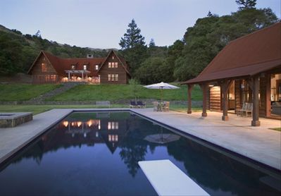 Lodge and pool house at dusk