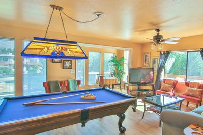 """The second floor living room is complete with an 8' full size pool table,  60"""" HDTV, seating for 6 as well as a 4 person breakfast table"""