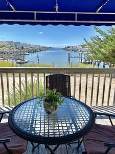 Photo for ENJOY BAY VIEWS!!  Bayfront home, shady front porch 2 boat docking areas, gameroom to watch TV,  A short bike ride or walk to Avalon's fine business district for ice cream, dining, mini golf, shopping and more.