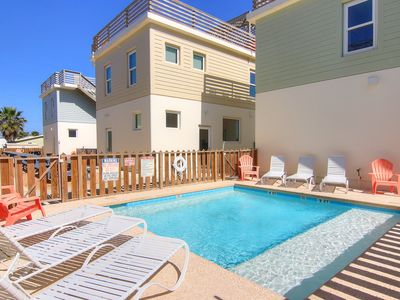 Photo for 4 bedroom/3 bath home! In town, shared pool, roof top terrace!