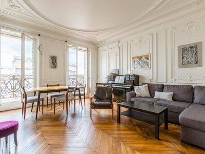 Photo for Spacious 3 BR with balcony views. Walk to the Eiffel Tower (Veeve)
