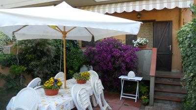 Photo for Lovely apartment in the house with a garden in the heart of Porto Ercole