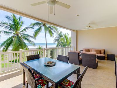 Photo for Oceanfront condo with sweeping beach views, private balcony & shared pool