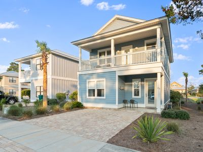 Photo for New Listing! Just two blocks from the white sandy beach!