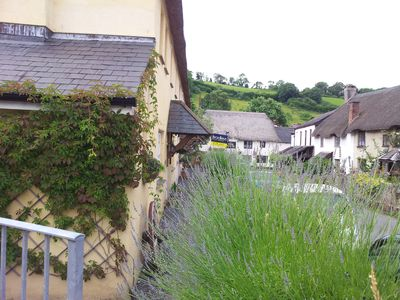 Photo for Thatched cottage in the 'chocolate box' village of Stokeinteignhead close to sea