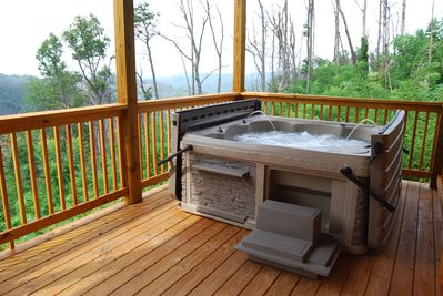 Hot Tub with views! Easy to open hard top with built in steps.