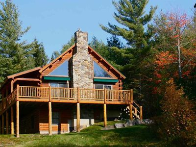 Private log cabin nestled on 14.5 acres in the White Mountains