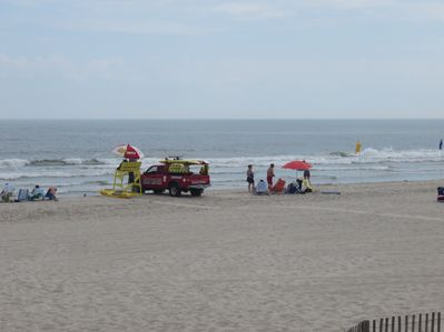 Our uncrowded beach with yellow lifeguard stand.