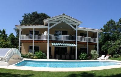 Photo for In the heart of Lacanau Océan golf, 2 guest rooms, with heated pool ...