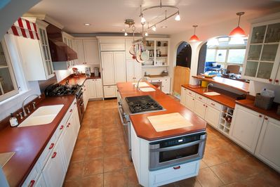 Enjoy open spacious kitchen with large center island, two ovens and three sinks.