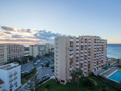 Photo for Views to the sea, beach, pool, tennis courts, air conditioning and Wifi !!