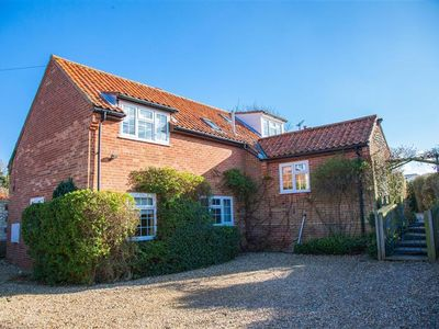 Photo for A fabulous four-bedroom detached property off the main coast road in Brancaster