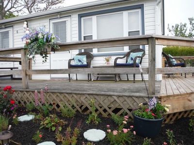 Corner view of deck, new garden and new patio furniture.