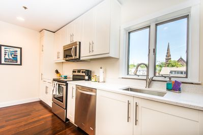 Newly renovated kitchen with stainless steel appliances and views of St. Mary's.
