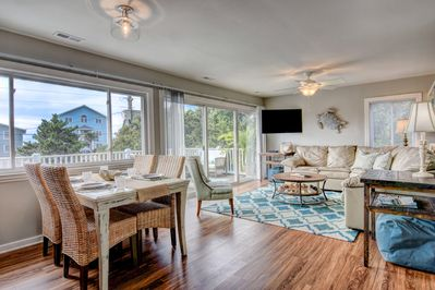Comfortable living room with sleeper sofa and space to share food and fun.