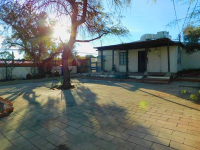 Photo for Cute central 3 Bedroom home shady yard, quiet neighborhood near U of A and UMC!