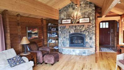 Large cozy living room with river rock fire place.