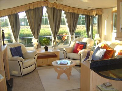 Photo for Modern caravan with great views - Pet Friendly . Award winning beaches nearby.