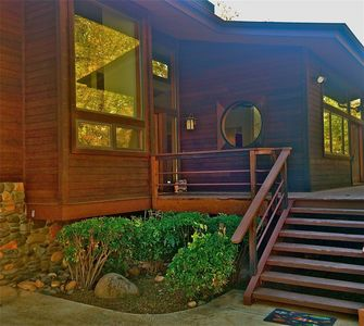 Main entrance with custom moon window. Huge front deck looking out to Red Rocks.