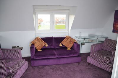 The lounge with a modern comfy sofa and two chairs